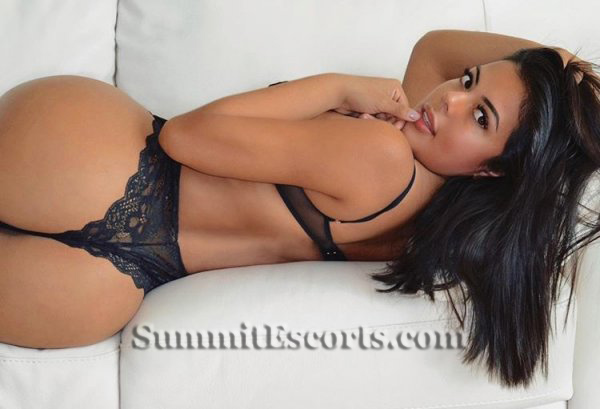 Gemma lying on a couch in sexy underwear